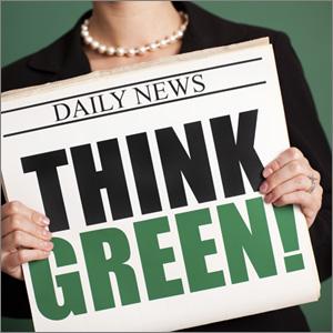Newspaper with headline Think green