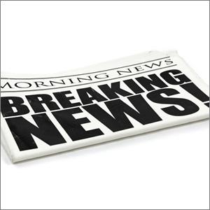Newspaper with headlinge Breaking news