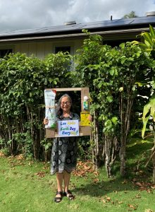 Photo of Gail hold eco-friendly sign