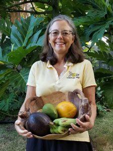 Photo of Kirsten holding basket of fruits