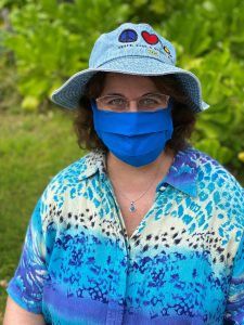 Photo of Maria in garden with mask