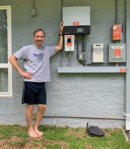 Photo of Alan with home PV inverter