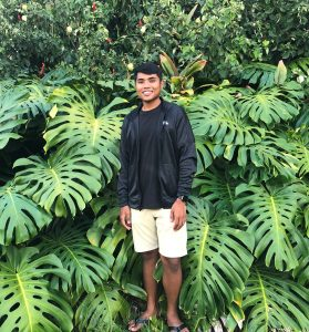 Photo of Chris and monstera plants