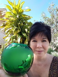 Photo of Kathy and green globe